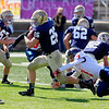 Record-Eagle/Jan-Michael Stump<br /> Boyne City's Jordan Wilmot (7) tries to tackle Traverse City St. Francis' Adam Armour (26) in the first half of Saturday's game.
