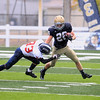 Record-Eagle/Jan-Michael Stump<br /> Boyne City's Conner Mills (33) tries to tackle Traverse City St. Francis' Adam Armour (26) in the third quarter of Saturday's game.