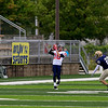 Record-Eagle/Jan-Michael Stump<br /> Boyne City's Maceo Vroman (10) catches a 66-yard touchdown pass in front of Traverse City St. Francis' Jimmy Brady (21) in the first quarter of Saturday's game.