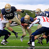 Record-Eagle/Jan-Michael Stump<br /> Traverse City St. Francis' Austin Currie (2) rushes for a touchdown in the second quarter of Saturday's game against Boyne City.