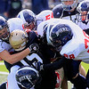 Record-Eagle/Jan-Michael Stump<br /> Traverse City St. Francis' Daniel Gallagher (15) gets tackled by a group of Boyne City defenders in Saturday's loss at Thirlby Field.