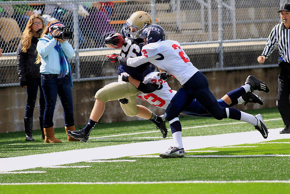Record-Eagle/Jan-Michael Stump<br /> Traverse City St. Francis' Adam Armour (26) gets knocked out of bounds by Boyne City's Bradley Fouchia (2) and Conner Mills (33) in the second quarter of Saturday's game.
