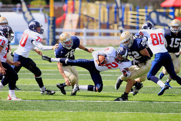 Record-Eagle/Jan-Michael Stump<br /> Boyne City's Bradley Fouchia (2) gets pulled down by Traverse City St. Francis' Malcom LaLonde (52) in the second quarter of Saturday's game.