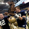 Record-Eagle/Jan-Michael Stump<br /> Traverse City St. Francis' Gabe Gallagher (42) and Peter Rigan (60) celebrate their 42-8 win over Hudson in Saturday's state final in Detroit.