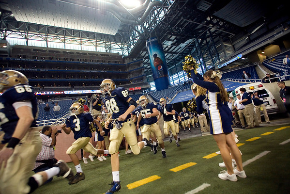 Record-Eagle/Jan-Michael Stump<br /> Traverse City St. Francis players take the field to face Hudson in Saturday's state final in Detroit.