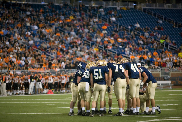 Record-Eagle/Jan-Michael Stump<br /> Traverse City St. Francis huddle in the first quarter of Saturday's state final win over Hudson in Detroit.