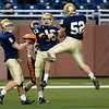 Record-Eagle/Jan-Michael Stump<br /> Traverse City St. Francis fullback Will Grombala (6), tight end Ian Sheldon (13) and offensive lineman Kyle Gallagher (52) celebrate Sheldon's 35-yard touchdown reception in the second quarter of Saturday's win over Hudson in the state finals in Detroit.