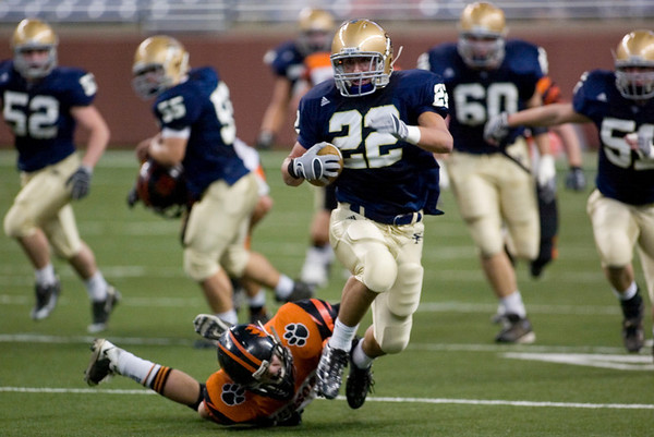 Record-Eagle/Jan-Michael Stump<br /> Traverse City St. Francis  half back Ben Swan (22) outruns Hudson linebacker Devan Marry (58) on a 69-yard touchdown run in the first quarter of in Saturday's state final in Detroit.