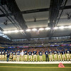 Record-Eagle/Jan-Michael Stump<br /> Traverse City St. Francis players stand for the national anthem before facing Hudson in Saturday's state final in Detroit.