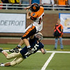 Record-Eagle/Jan-Michael Stump<br /> Traverse City St. Francis defensive back Jacob Schell (5) hurries Hudson quarterback Nathan Smith (10) in Saturday's state final in Detroit.