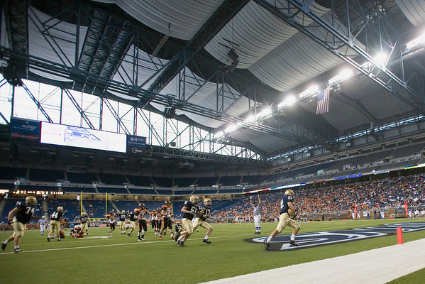 Record-Eagle/Jan-Michael Stump<br /> Traverse City St. Francis halfback Ben Swan (22) scores on a 16-yard run in the fourth quarter of Saturday's 42-8 win over Hudson in Saturday's state final in Detroit.