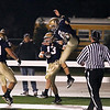 Record-Eagle/Jan-Michael Stump<br /> St. Francis running back Seth Kellicut (13) and tight end Kevin Banducci (2) celebrate a two-point conversion in the second half of Friday's win over Lake City.