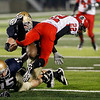 Record-Eagle/Jan-Michael Stump<br /> Lake City wide receiver Nathan Holt (22) fumbles while being hit by St. Francis defensive end Zach Swaffer (45) and defensive lineman Isaiah Schaub (15) in the second half of Friday's game. The fumble was recovered by St. Francis defensive end Jack Broadeur (not pictured)