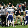 Record-Eagle/Keith King<br /> The Traverse City St. Francis defense celebrates after a referee signals that they've recovered a fumble against Nouvel Catholic Central Friday, September 3, 2010 at Thirlby Field.
