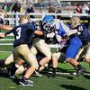 Record-Eagle/Keith King<br /> Ishpeming's Casey McCullough is brought down by a host of Traverse City St. Francis defenders Saturday, November 12, 2011 at Thirlby Field in Traverse City.