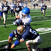 Record-Eagle/Keith King<br /> Ishpeming's Casey McCullough is tackled by Traverse City St. Francis' Byron Bullough Saturday, November 12, 2011 at Thirlby Field in Traverse City.