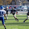 Record-Eagle/Keith King<br /> Traverse City St. Francis' Devin Sheehy-Guiseppi runs the ball against Ishpeming Saturday, November 12, 2011 at Thirlby Field in Traverse City.