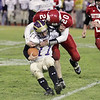 Record-Eagle/Keith King<br /> Suttons Bay's Aiden Keilty tackles Farwell's Cody Wilkerson Friday, November 5, 2010 at Suttons Bay High School.