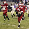 Record-Eagle/Keith King<br /> Suttons Bay's Layton Korson runs on his way to scoring a second-quarter touchdown against Farwell Friday, November 5, 2010 at Suttons Bay High School.