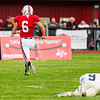 Record-Eagle/Brett A. Sommers Benzie Central's Saunder Stoltz (6) caught a 55-yard touchdown pass and broke the tackle of Traverse City St. Francis' Dylan McCardel in the process during Friday's football game.