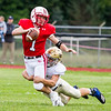 Record-Eagle/Brett A. Sommers Benzie Central quarterback Joe Wade is sacked by Traverse City St. Francis linebacker Aidan Schmuckal during Friday's football game.