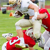 Record-Eagle/Brett A. Sommers Traverse City St. Francis running back Evan McGee hurdles Benzie Central's Darren Childs during Friday's football game.