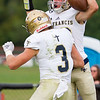 Record-Eagle/Brett A. Sommers Traverse City St. Francis quarterback Danny Passinault celebrates a touchdown with teammate Evan McGee during Friday's football game against Benzie Central.