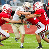 Record-Eagle/Brett A. Sommers Traverse City St. Francis quarterback Dany Passinault takes on three Benzie Central tacklers during Friday's football game.