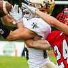 Record-Eagle/Brett A. Sommers Traverse City St. Francis defensive back Artie Dutmers intercepts the ball, fighting Benzie Central Caleb Walmsley for the ball, during Friday's football game.