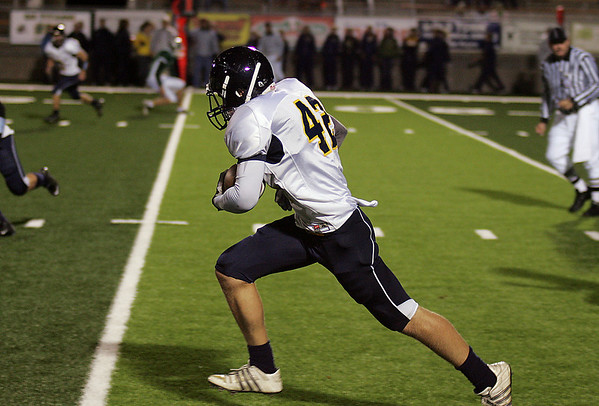 Record-Eagle/ Keith King<br /> Gaylord's Dillon Hunt runs the ball against Traverse City West after catching an interception Friday, September 24, 2010 at Thirlby Field.