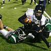Record-Eagle/ Keith King<br /> Gaylord's Trae Hill carries the ball against Traverse City West's Zane Rusinowski, left, and Collin Richards Friday, September 24, 2010 at Thirlby Field.