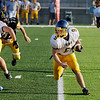 Record-Eagle/Keith King<br /> Cadillac's Nolan Goerner runs the ball against Traverse City Central Thursday, September 1, 2011 at Thirlby Field.