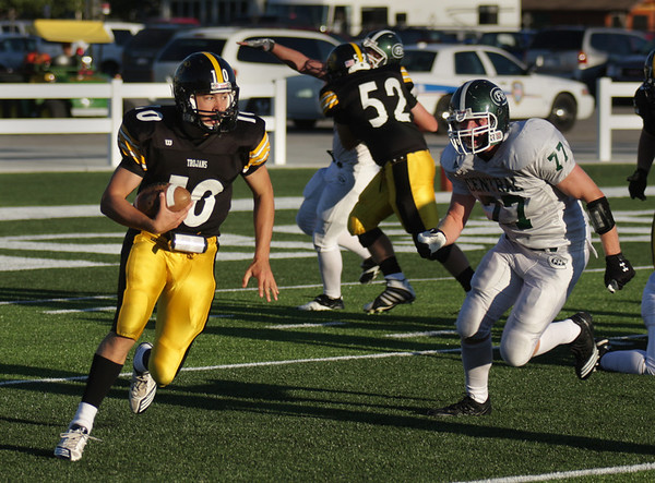 Record-Eagle/Keith King<br /> Traverse City Central's Mack Sovereign tries to elude Forest Hills Central's James Nutter Thursday, August 26, 2010 at Thirlby Field.
