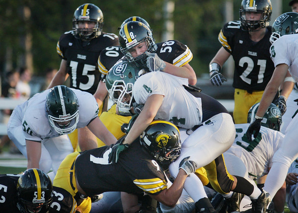 Record-Eagle/Keith King<br /> Traverse City Central's Brad Keller, top, and Sheldon Berry, bottom, tackle Forest Hills Central's Collin Schlosser Thursday, August 26, 2010 at Thirlby Field.