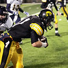 Record-Eagle/Keith King<br /> Traverse City Central's Ryan Verschuren runs the ball as Gaylord's Dan Plumstead closes in Friday, October 14, 2011 at Thirlby Field in Traverse City.