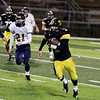 Record-Eagle/Keith King<br /> Traverse City Central's T.J. Schepperly runs the ball against Gaylord Friday, October 14, 2011 at Thirlby Field in Traverse City.