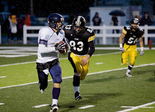 Record-Eagle/Keith King<br /> Gaylord's Trevor Huff tries to elude Traverse City Central's Connor McGraw Friday, October 14, 2011 at Thirlby Field.