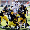 Record-Eagle/Keith King<br /> Traverse City Central's Connor McGraw, from left, Jordan Lutze, T.J. Schepperly, Boone Marois and Joe Prokes, underneath, tackle Menominee's Jacob Mathieu Saturday, October 22, 2011 at Thirlby Field in Traverse City.