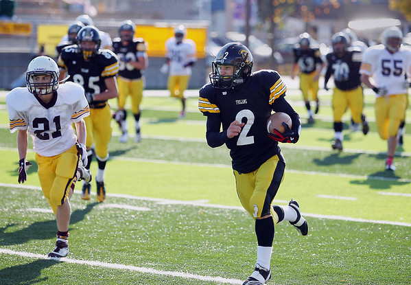 Record-Eagle/Keith King<br /> Traverse City Central's T.J. Schepperly runs the ball against Menominee Saturday, October 22, 2011 at Thirlby Field in Traverse City.
