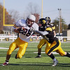 Record-Eagle/Keith King<br /> Traverse City Central's Dylan Kelly works to bring down Menominee's Connor LaPlante Saturday, October 22, 2011 at Thirlby Field in Traverse City.