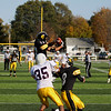 Record-Eagle/Keith King<br /> Traverse City Central's Joe Prokes intercepts a pass intended for Menominee's Branardo Olsen (35) Saturday, October 22, 2011 at Thirlby Field in Traverse City.