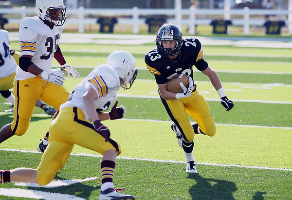 Record-Eagle/Keith King<br /> Traverse City Central's T.J. Schwannecke runs the ball against Menominee Saturday, October 22, 2011 at Thirlby Field in Traverse City.