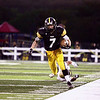 Record-Eagle/Keith King<br /> Traverse City Central's Tyler Clark runs the ball against Ogemaw Heights Friday, September 23, 2011 at Thirlby Field in Traverse City.