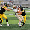 Record-Eagle/Keith King<br /> Ogemaw Heights' Timothy Howard, middle, is stopped by Traverse City Central's Weston deTar, right, as teammate Joe Prokes, left, moves in Friday, September 23, 2011 at Thirlby Field in Traverse City.