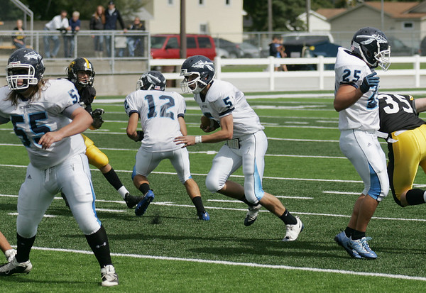 Record-Eagle/Keith King<br /> Petoskey's Ky Lewis runs the ball against Traverse City Central Saturday, September 18, 2010 at Thirlby Field.