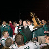 Record-Eagle/Jan-Michael Stump<br /> Traverse City West coach Tim Wooer talks with his players with the Nowak-Olson Trophy following Friday's 51-42 win over Traverse City Central.