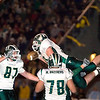 Record-Eagle/Jan-Michael Stump<br /> Traverse City West's Cody Scheuerman (10) celebrates his second quarter touchdown with teammates in Friday's 51-42 win over Traverse City Central.