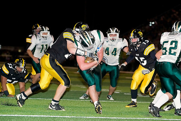 Record-Eagle/Jan-Michael Stump<br /> Traverse City Central's Ben Broad (21) tries to tackle Traverse City West's Morgan Tolle (28) as he scores late in the fourth quarter of Friday's game.