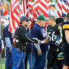 "Record-Eagle/Jan-Michael Stump<br /> Traverse City Central players greet veterans during opening ""Patriot Game"" ceremonies before Friday's game against Traverse City West."