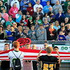 "Record-Eagle/Jan-Michael Stump<br /> Students hold a giant American Flag during opening ""Patriot Game"" ceremonies before Friday's game against Traverse City Central."